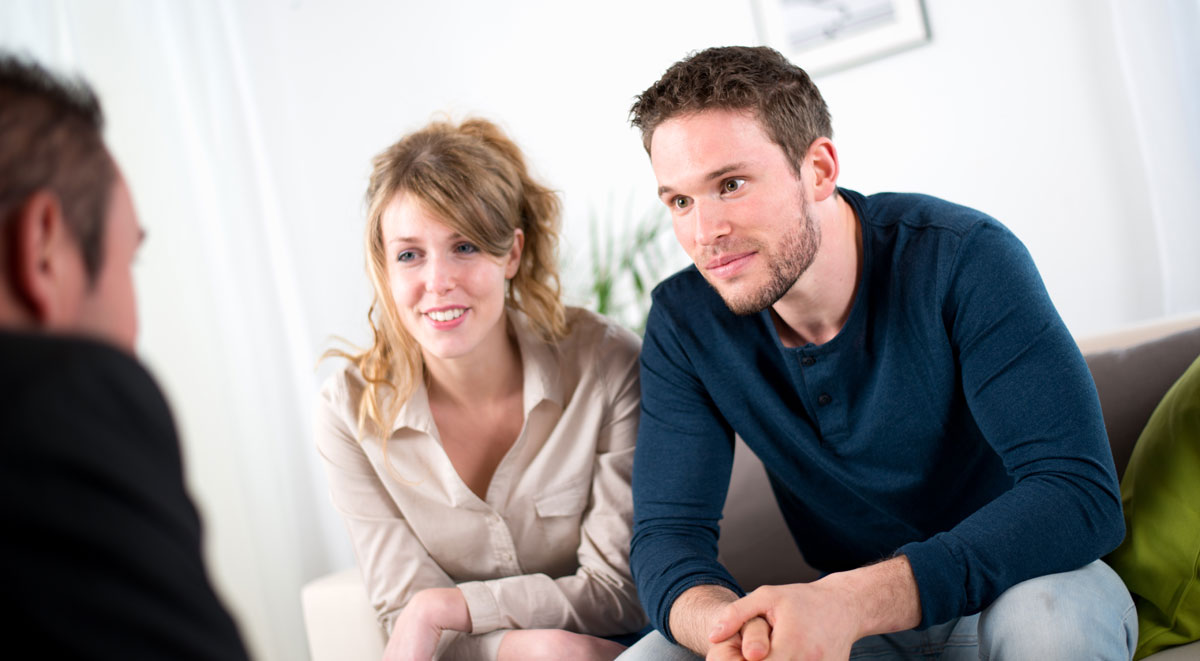 Couple on Sofa During In-Home Consultation