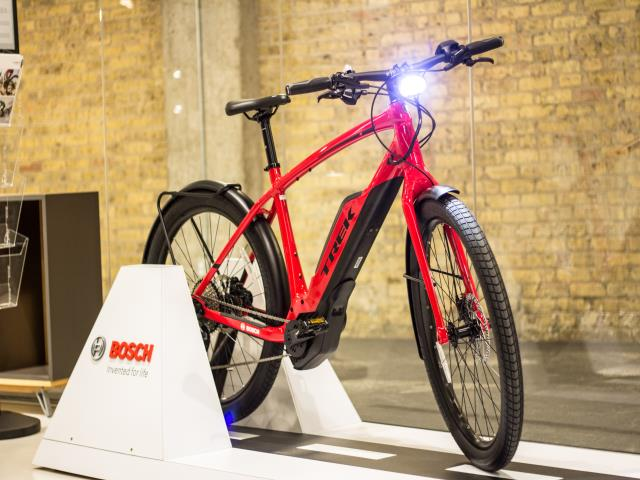 Bosch Trek Red eBike with Light On | Chicago Connectory